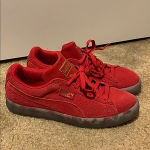 Red Puma Classic Suede Shoes with floral bottoms